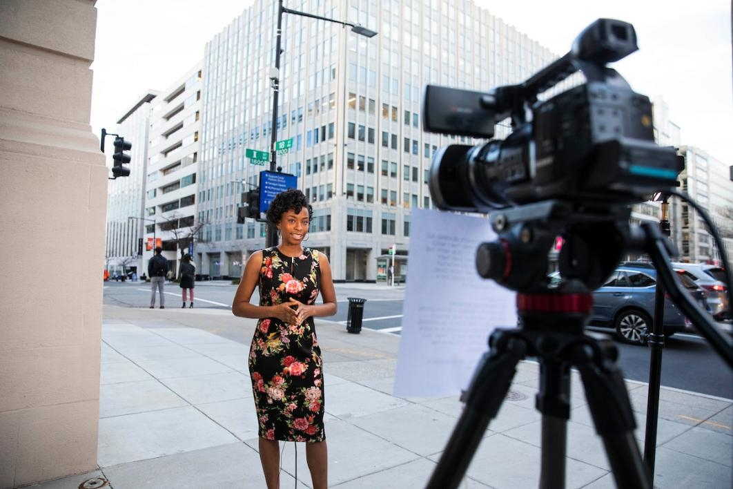 Woman in front of news camera