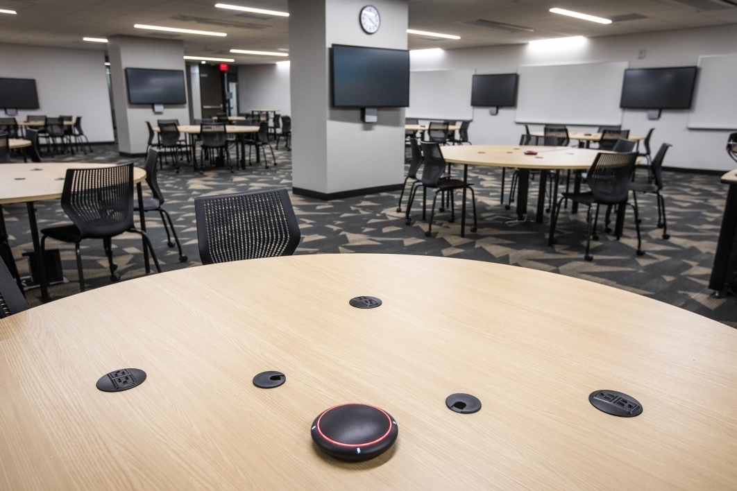 round tables and television screens in a classroom