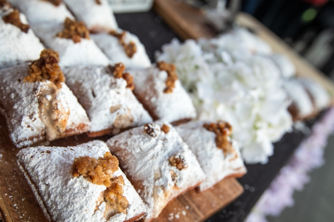 A closeup of Beignet Babe traditional French beignets