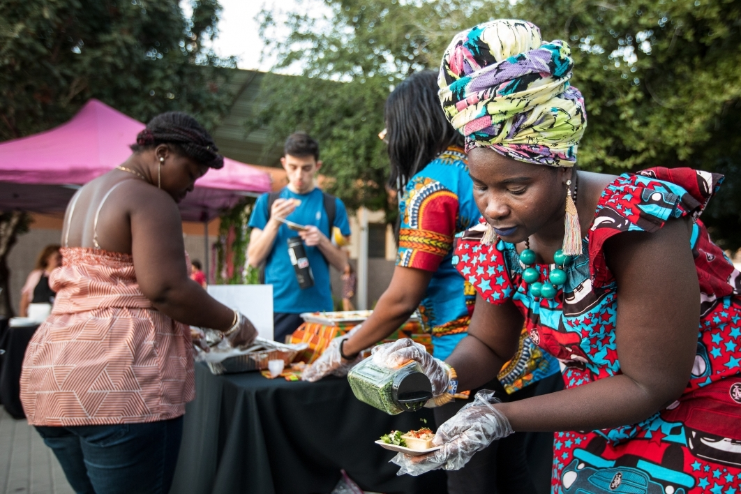 Ohemaa Afro Fusion Cuisine server Lovelyn Omari prepares a dish