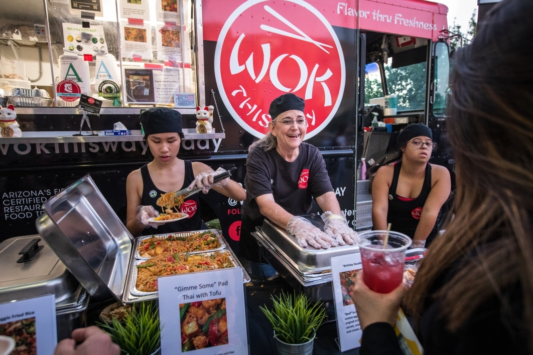 Wok This Way server Ellyn Starikoff chats with customers