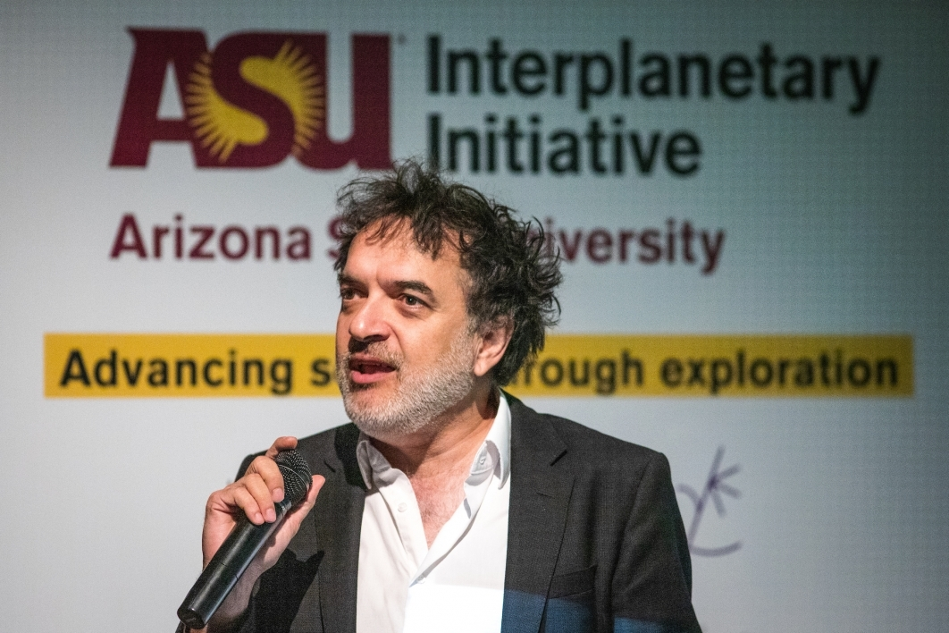 A man speaks onstage at the ASU Space to Thrive space missions panel