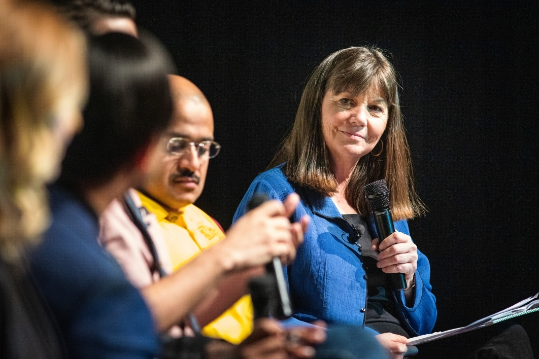 A woman speaks onstage at the ASU Space to Thrive space missions panel