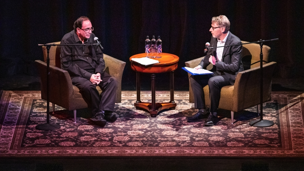 R. L. Stine and ASU Dean of Humanities Jeffrey Cohen seated on stage at the Orpheum Theatre in Phoenix