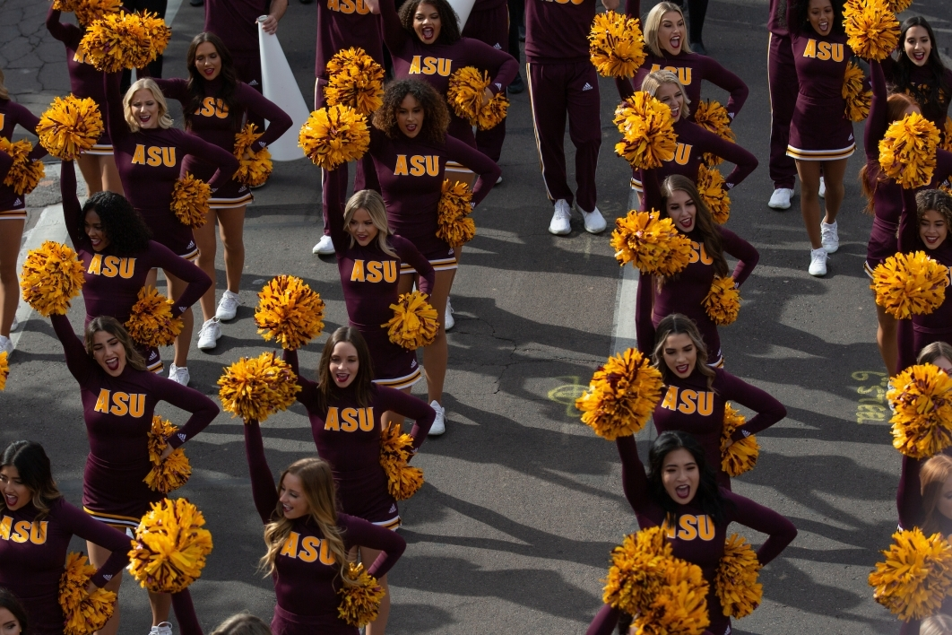 cheerleaders march in the homecoming parade