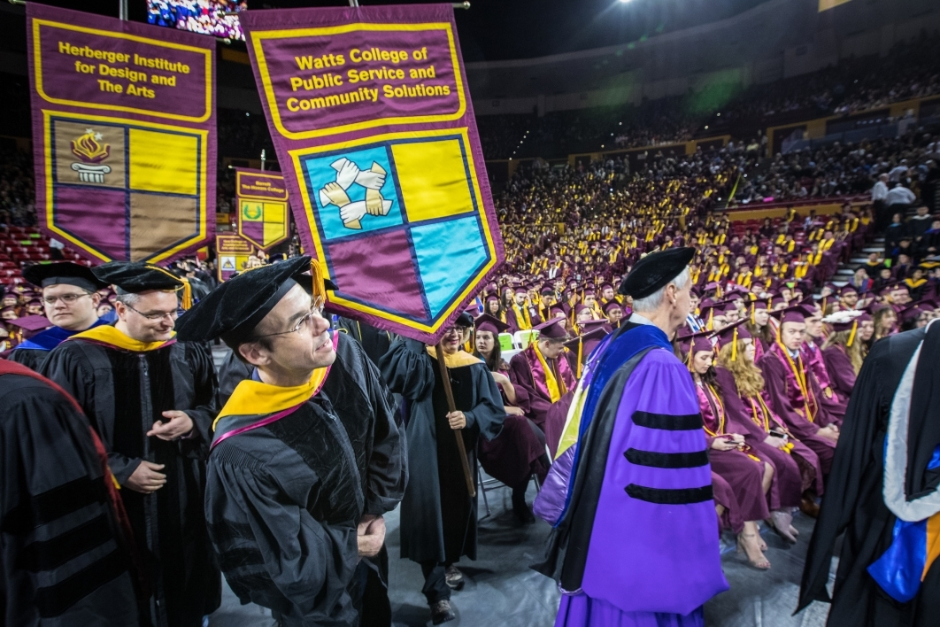 faculty carrying gonfalons at graduation
