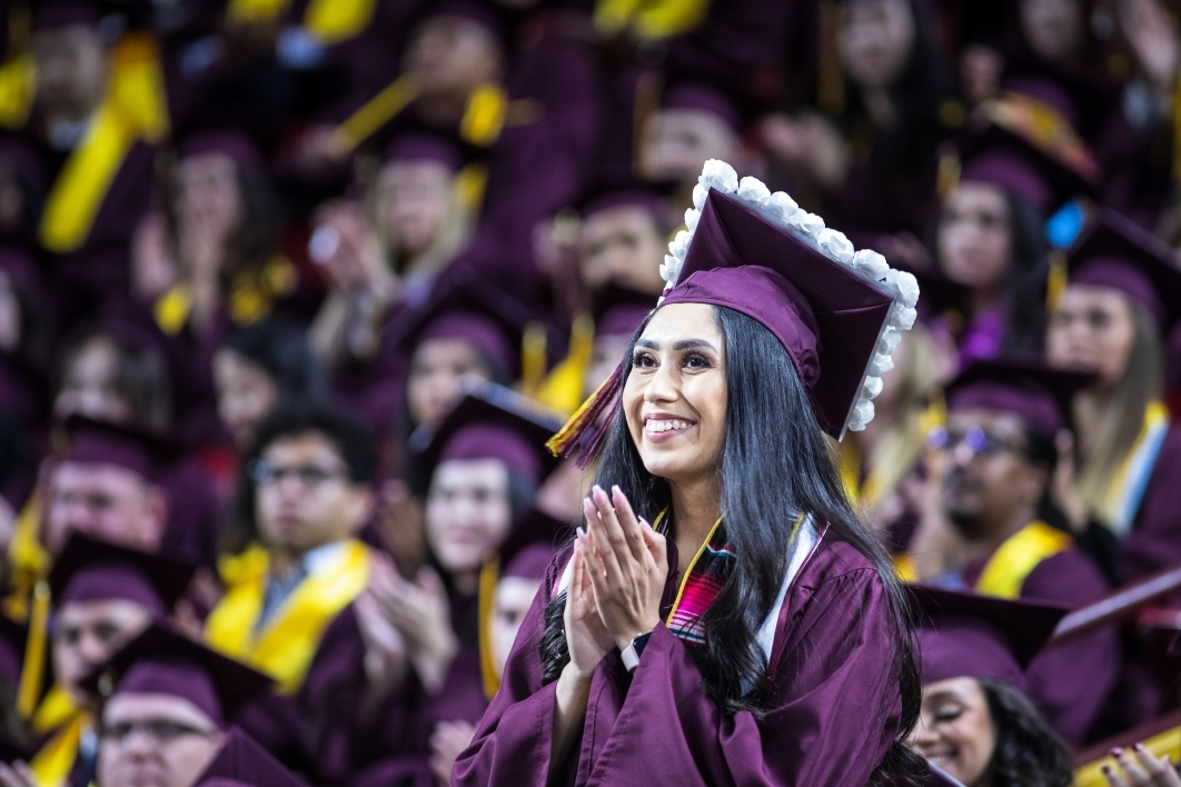 woman standing at commencement