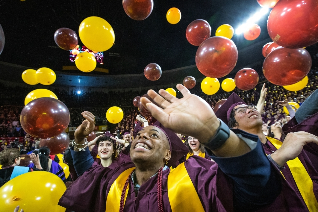 balloons dropping from ceiling at graduation