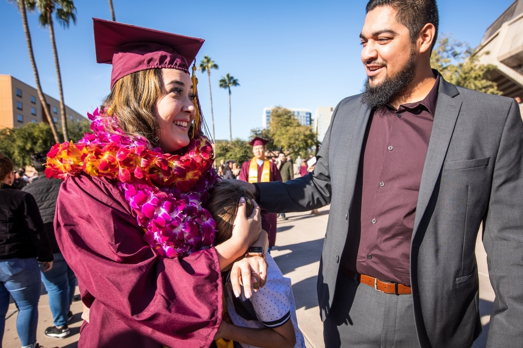 two people talking after graduation