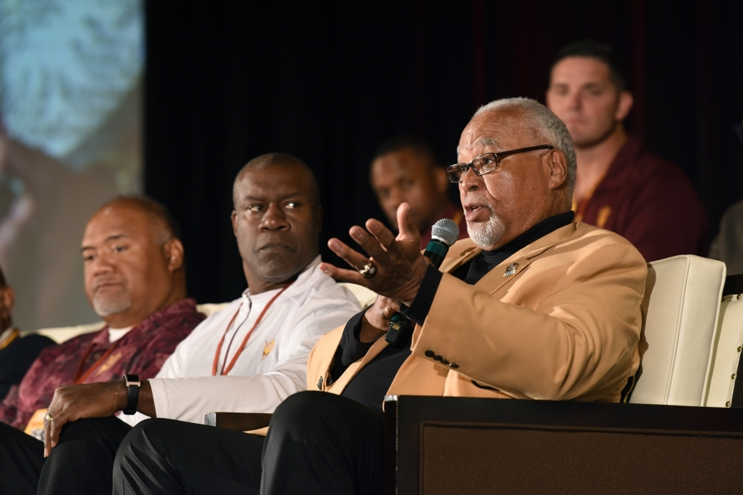 A former player speaks onstage at the Sun Devils Legends lunch