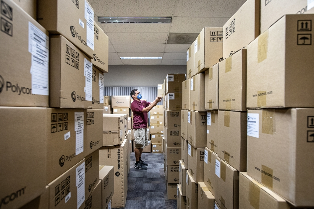 UTO tech looks at stacks of boxes