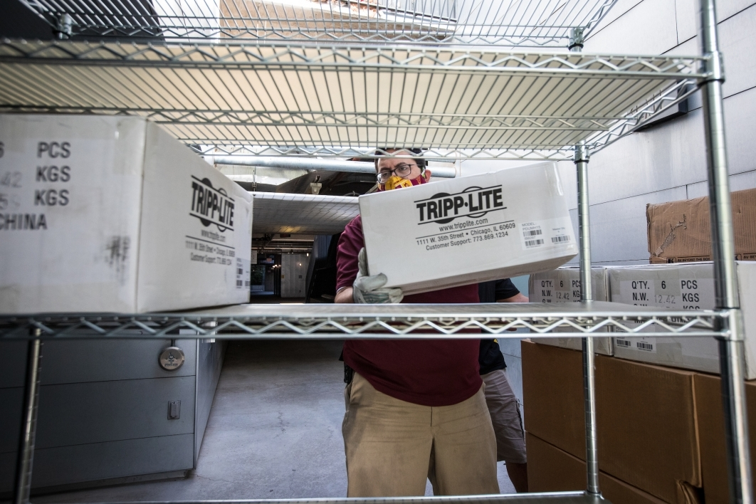 ASU employee organizes boxes of AV equipment
