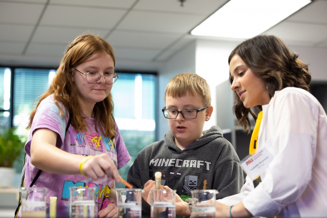 teenage girl and boy learn about ph from a scientist