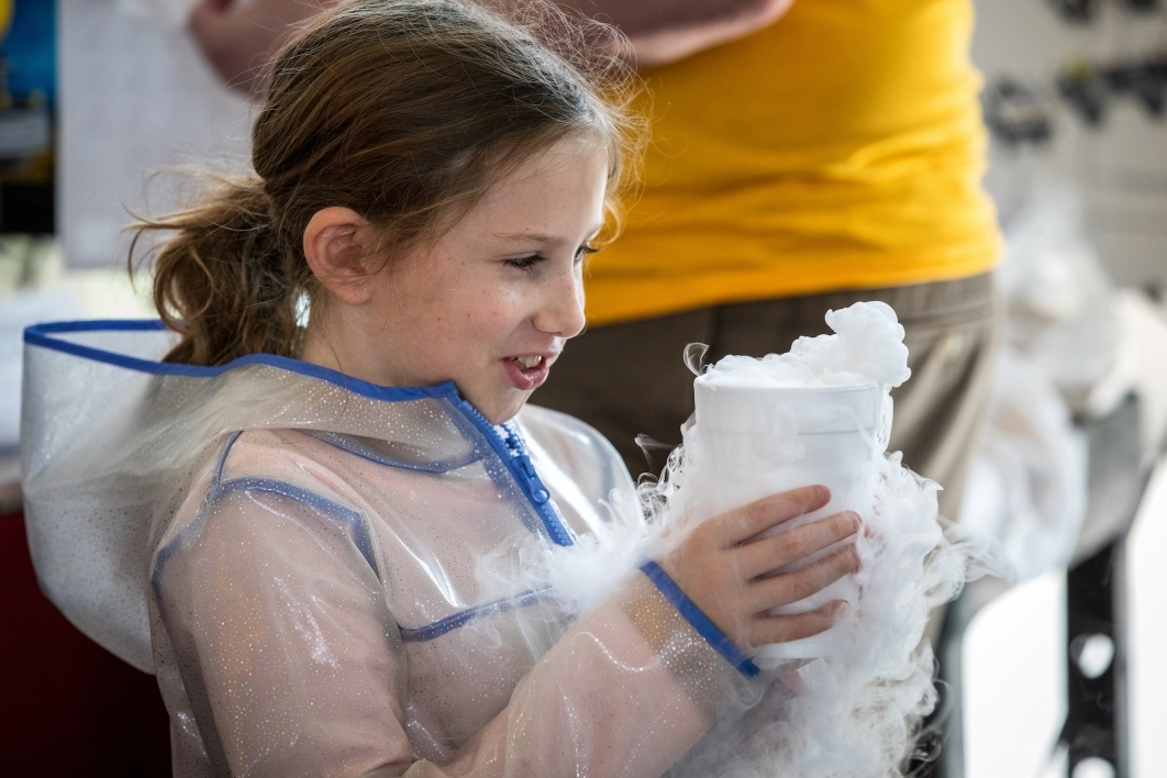 girl holding cup of dry ice