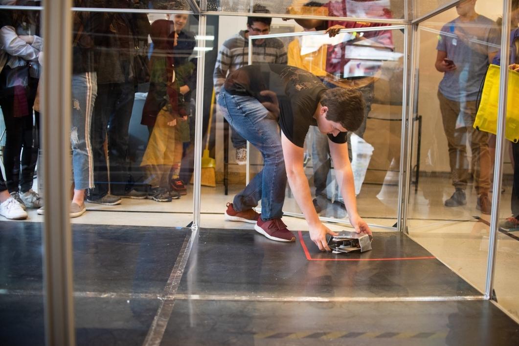 man placing robot down