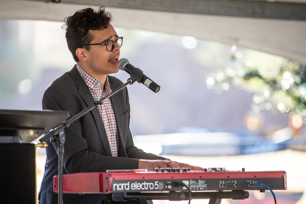 musician plays keyboards