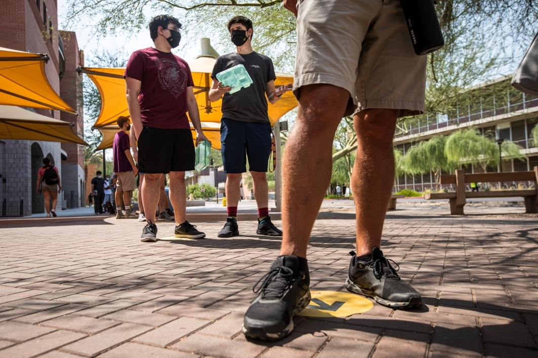 Students wait in a socially distanced line to get into the ASU bookstore on the first day of class