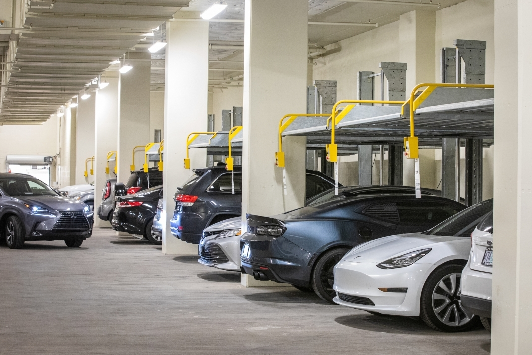 A parking garage with hydrolic lifts to allow the cars to be stacked on top of each other