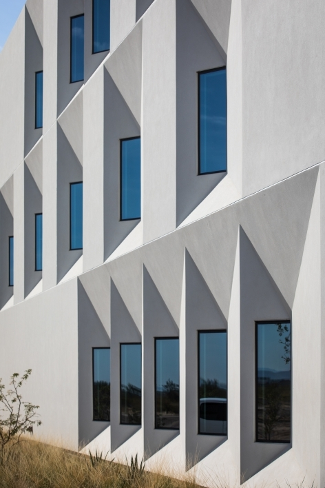 Photo of a row of windows on a white building