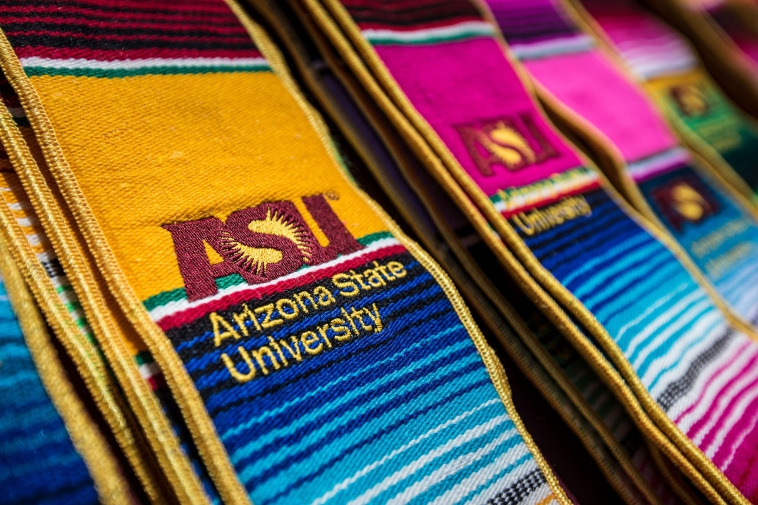 ASU Hispanic convocation stoles sit in stacks for students to use during graduation photos