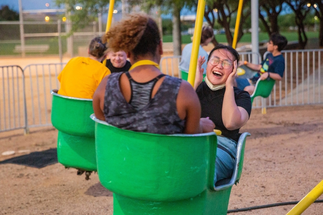 Woman laughing on a carnival swing ride