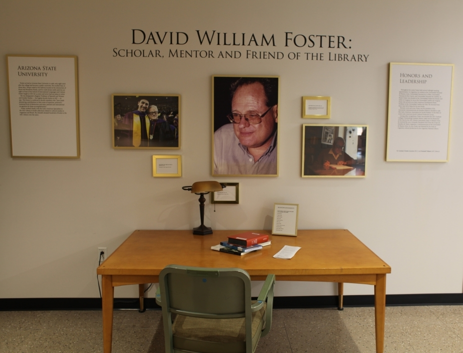 memorial exhibit at library with photos and a desk