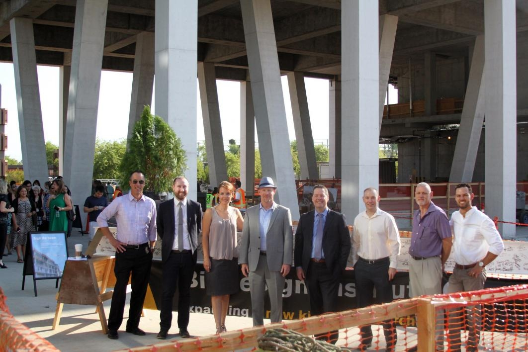 People pose for a photo at the Biodesign C topping-out ceremony