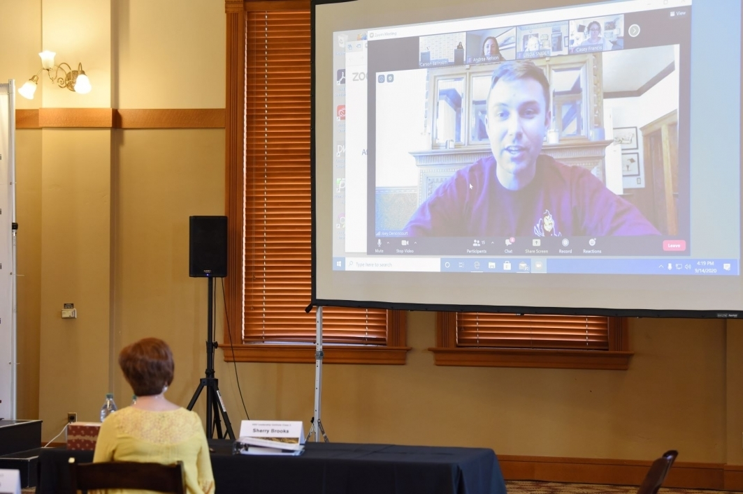 person speaking on screen via Zoom to people at ASU's Tempe campus