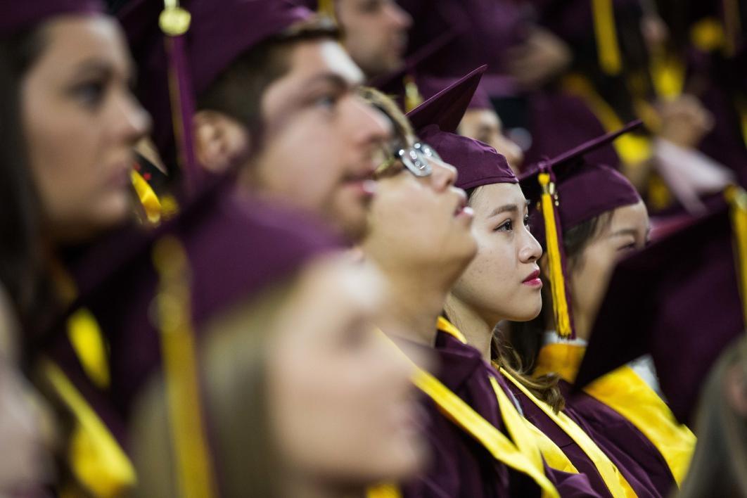 students listening to speaker at graduation