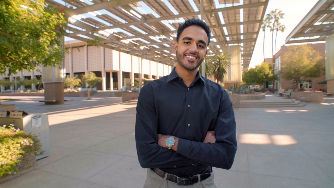 Nikhil Dave, researcher in the ASU-Banner Neurodegenerative Disease Research Center at the Biodesign Institute, smiles for a portrait on the ASU Tempe campus