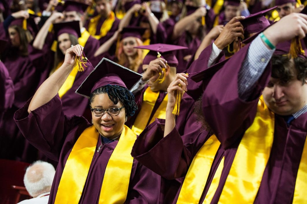graduates moving their tassels at commencement
