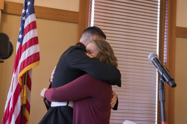 ASu student Jake HUnter and sister Cassidy HUnter embrace on state at ASU