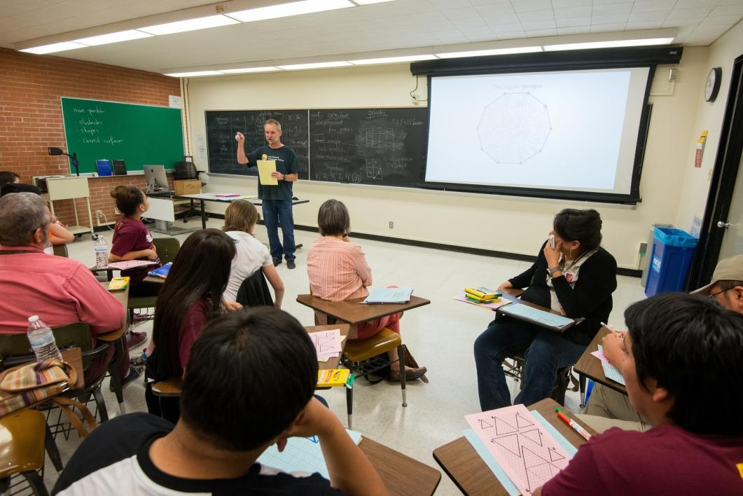 man speaking to classroom full of students