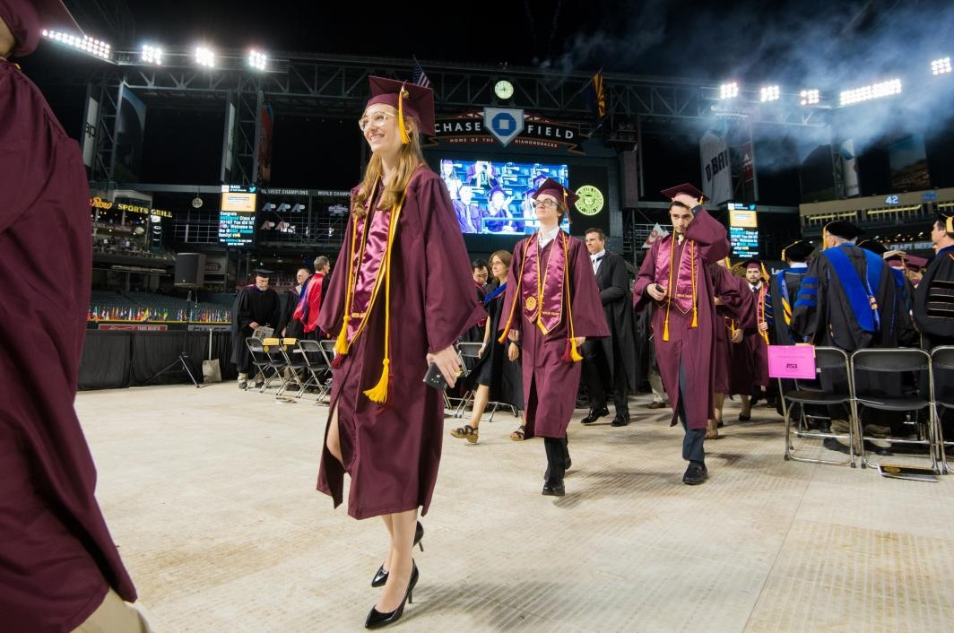 students exiting graduation