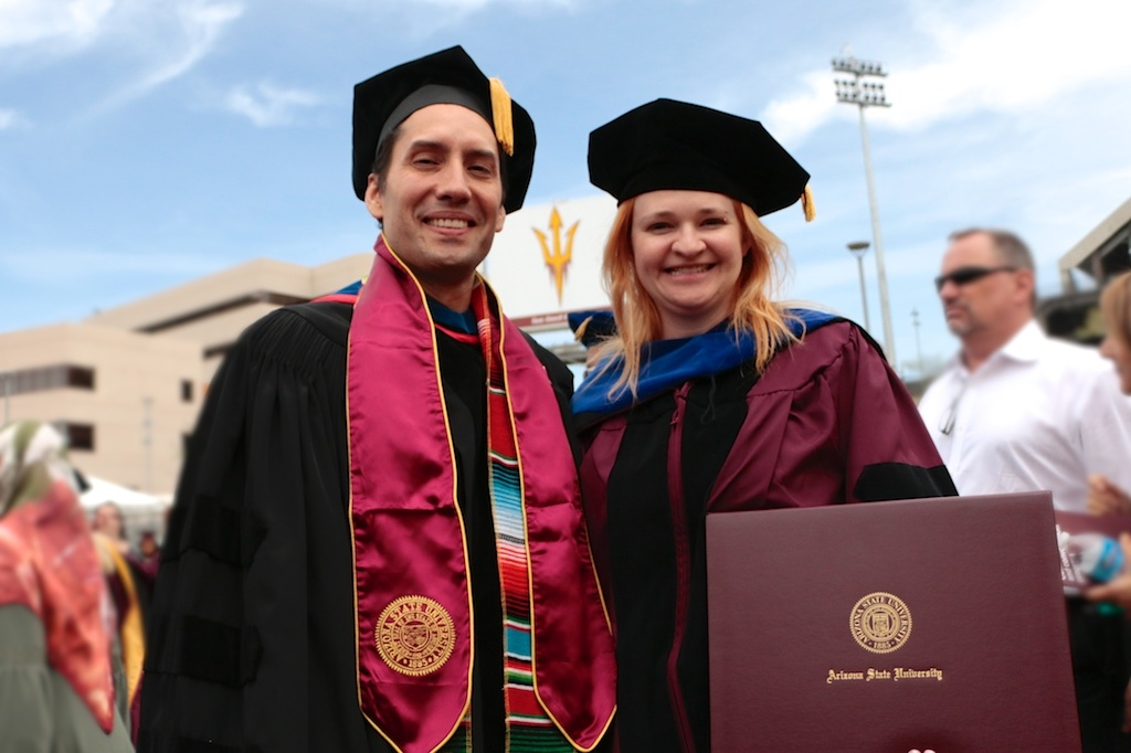 Wendy Caldwell celebrates with her advisor, Stephen Wirkus, after ASU Graduate Commencement