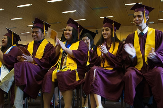 students clapping at convocation