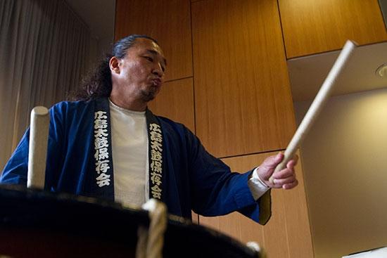 man drumming at convocation