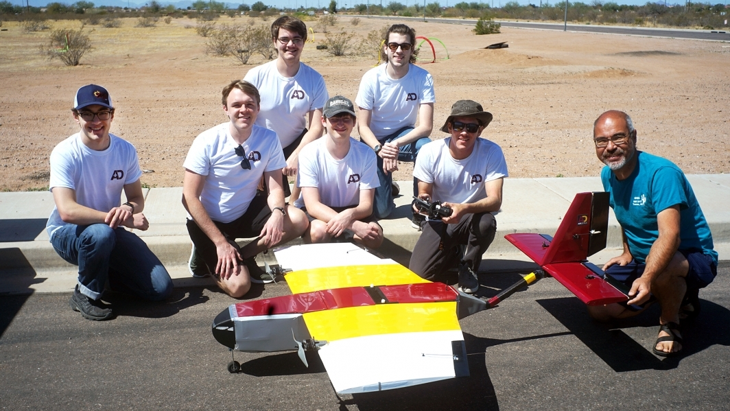 A photo of the Air Devils team member and their 2020-2021 AIAA Design/Build/Fly competition aircraft.
