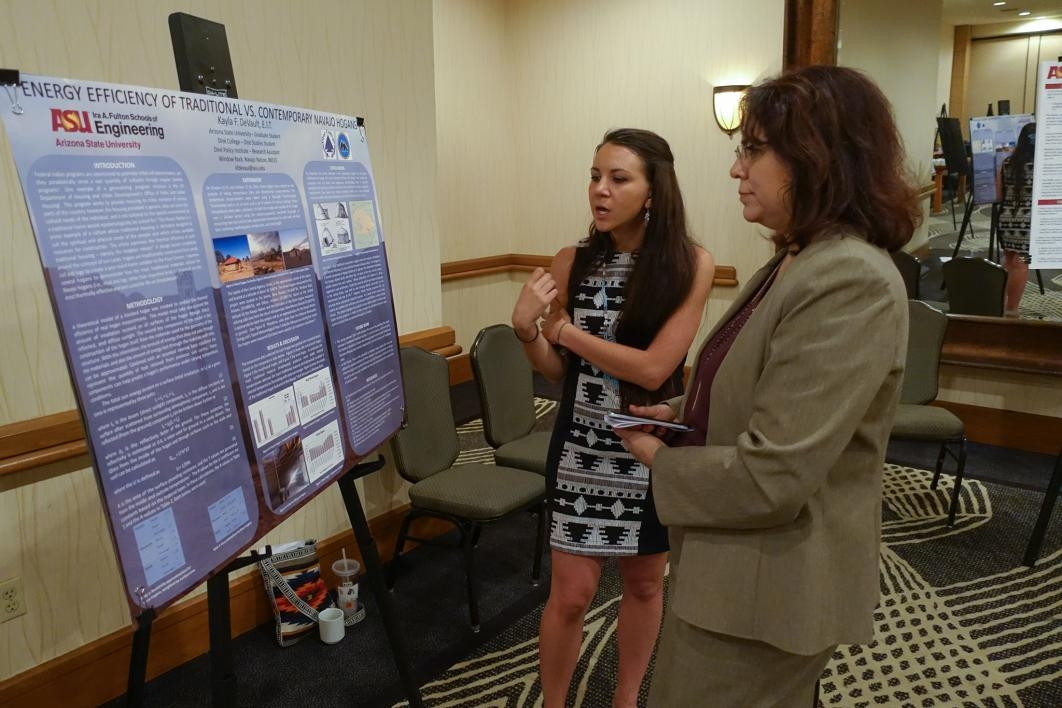 ASU graduate student Kayla DeVault discusses her research poster