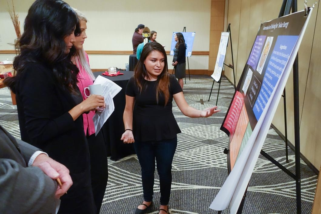 AIS 440 student Sarahna Cooper presents poster for her community development proposal