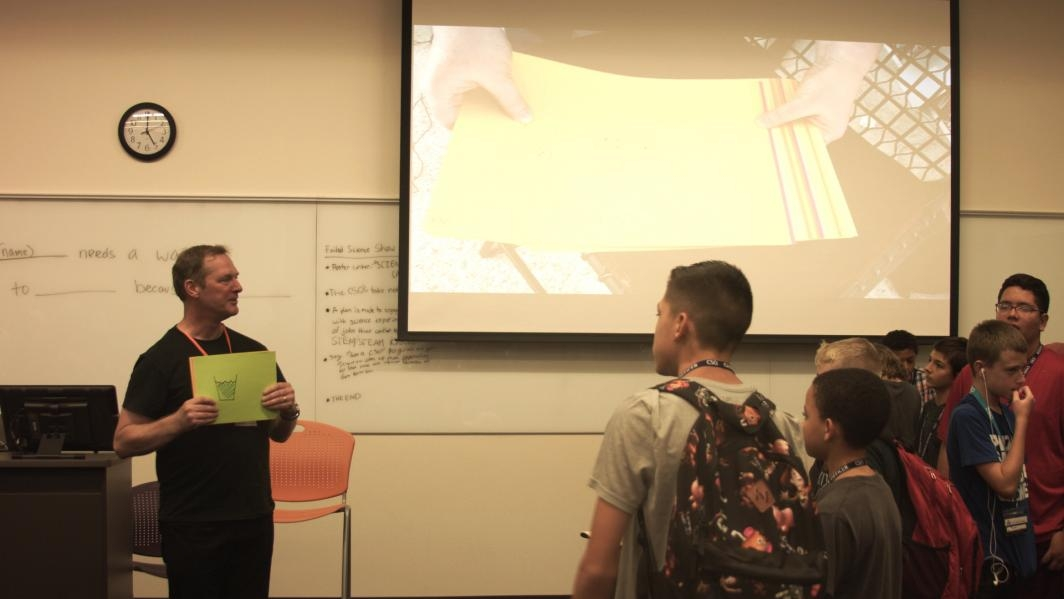 "Andrew Maynard, shows students at Chief Science Officers to make ""Flip Book"" videos."