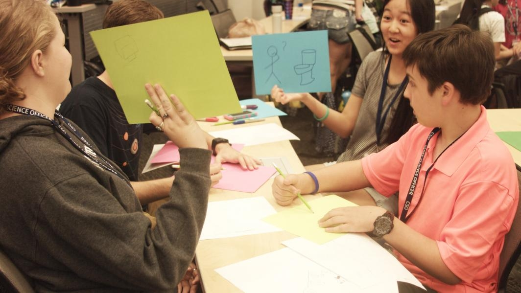 "Students at the Chief Science Officers (CSO) Summer Institute sketch pages for a ""Flip Book"" video."