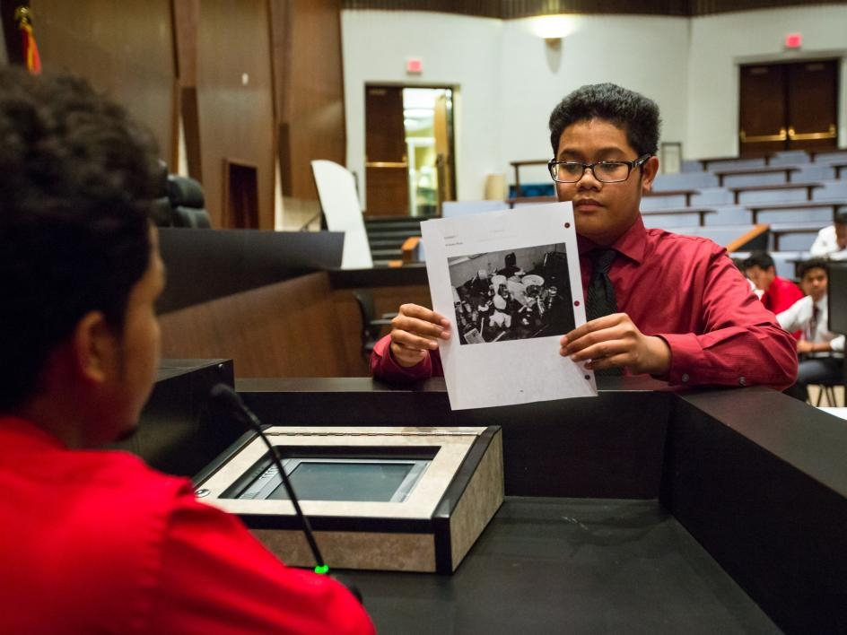 High schoolers present evidence at a mock trial at APACE Academy