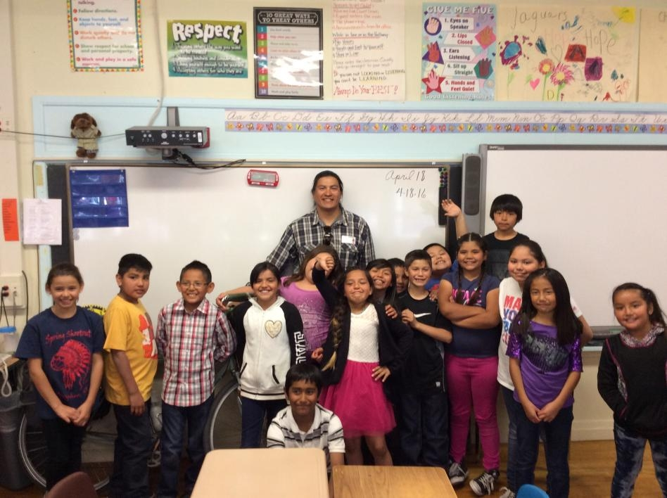 ASU master's student Kenny Dyer-Redner with a class of Native students