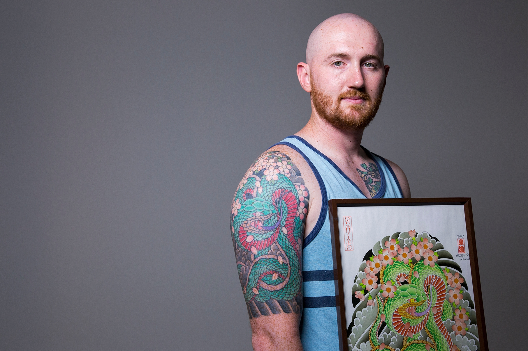 man posing with art of tattoo