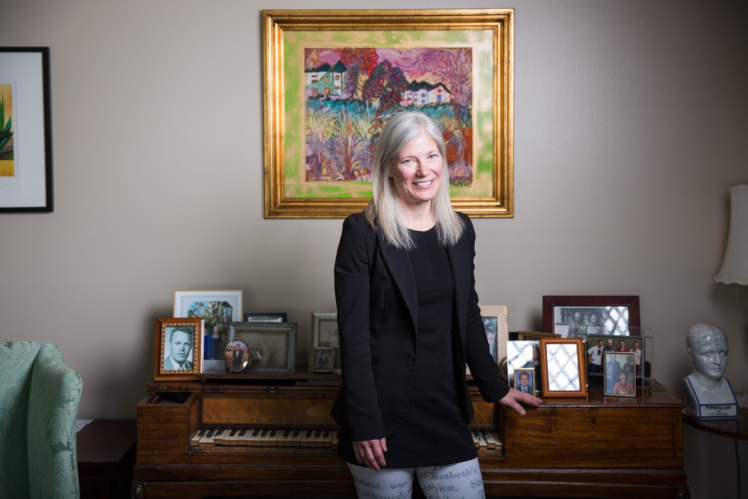 woman standing in front of piano in living room
