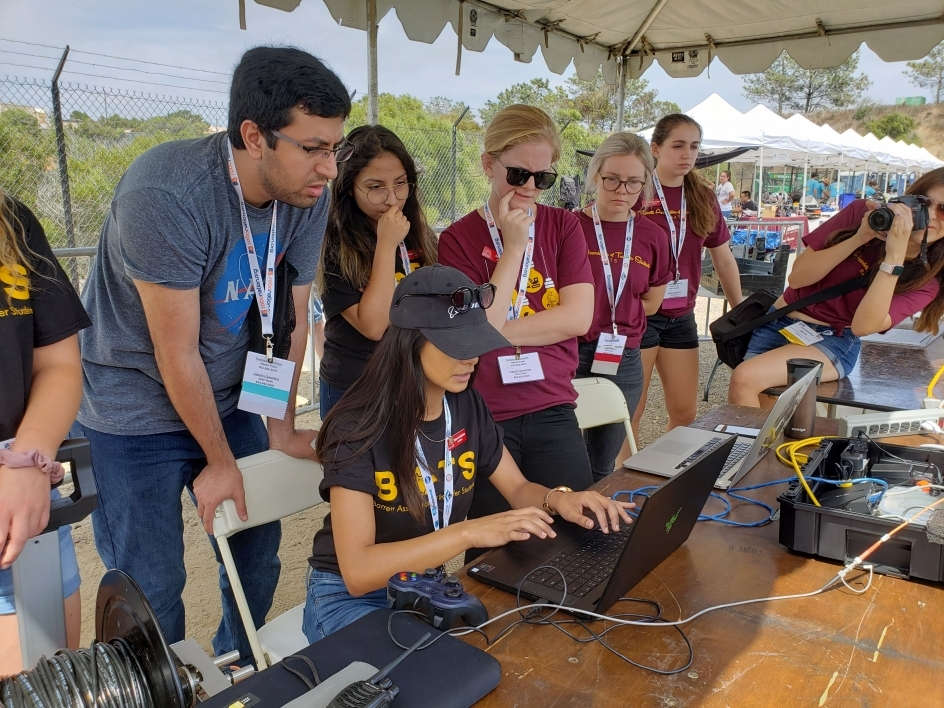 ASU students look at a computer at the RoboSub 2019 competition