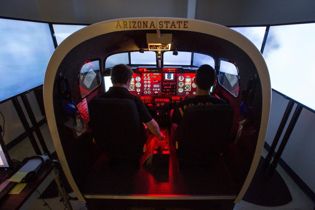 Aviation students in a flight simulator.