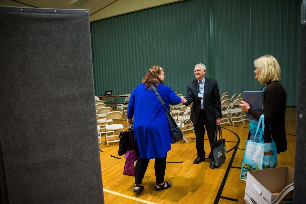 Dean Roen greets guests