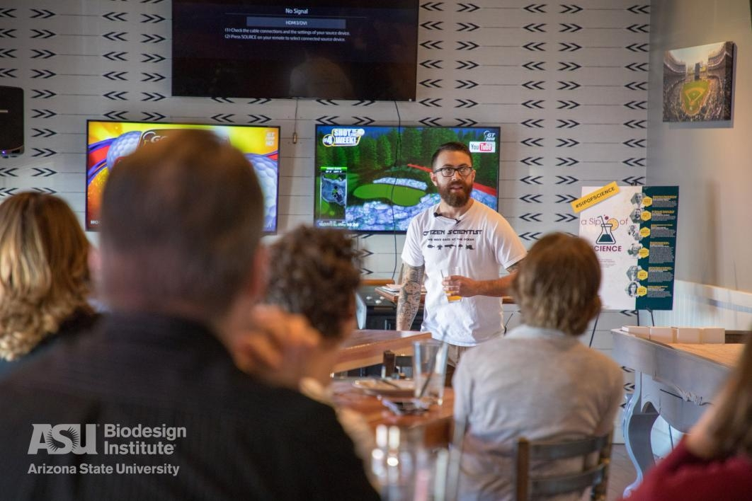 "Biodesign's Charlie Rolsky presents about his work at the second ""Sip of Science"" event"